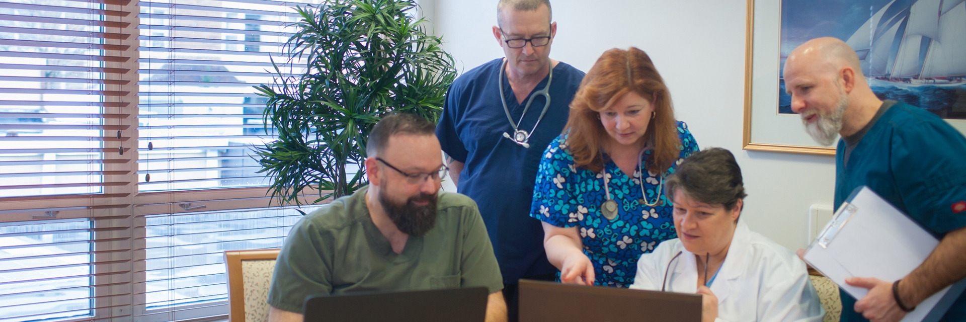 Attentive and Skilled Nurses reviewing a computer screen