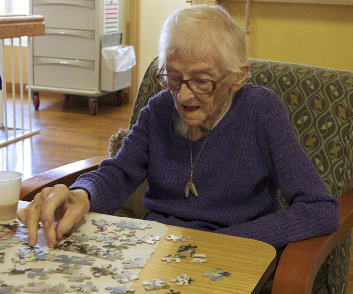 A resident working on a puzzle